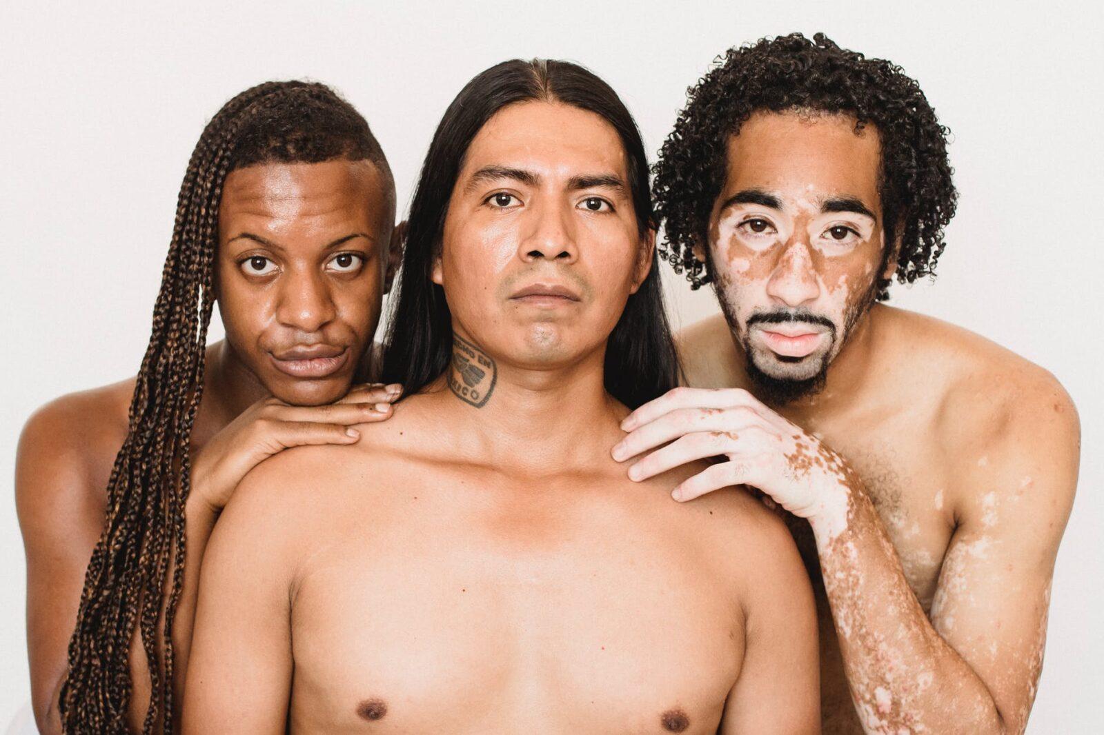 feminine diverse shirtless men on white background